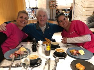 Dreams project with elderly lady and nurse caregiver having breakfast