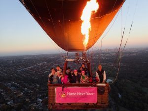 Dreams project with elderly lady and nurse caregiver group photo in balloon