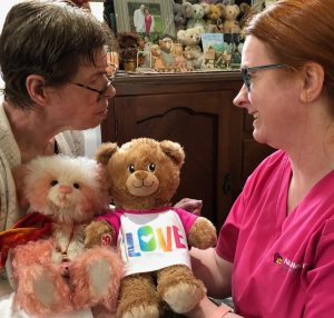 Nurse Next Door home care client Helen with her carer and her favourite teddies