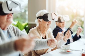 Shot of happy senior women using virtual reality headsets together at a retirement home