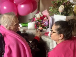A Nurse Next Door registered nurse surprises her client with balloons and presents on her 100th birthday