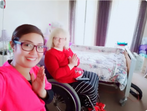 A Nurse Next Door caregiver finishes a wheelchair yoga session with her client